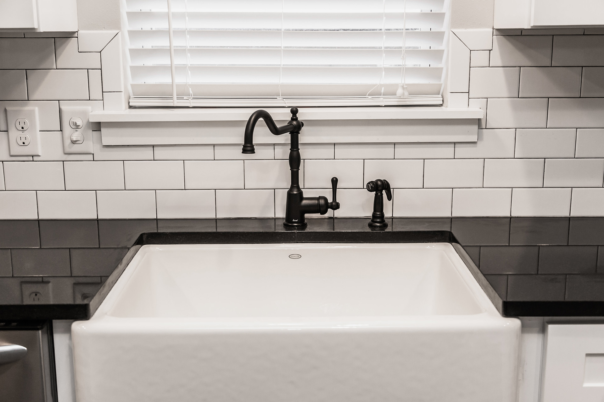 Matte black kitchen faucet, white subway tile backsplash, farmhouse sink, farm sink, apron front kitchen sink, single basin kitchen sink