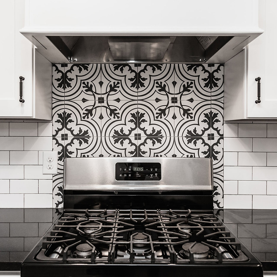 "30"" range, absolute black granite, white and black kitchen, ceramic field tile in vintage charcoal backsplash"